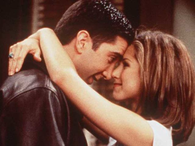 When does Ross kiss Rachel for the first time?