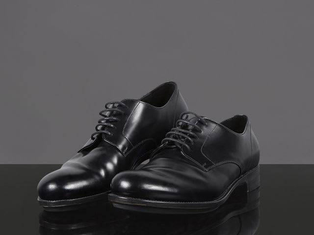 Who is the owner of these shiny black leather shoes?