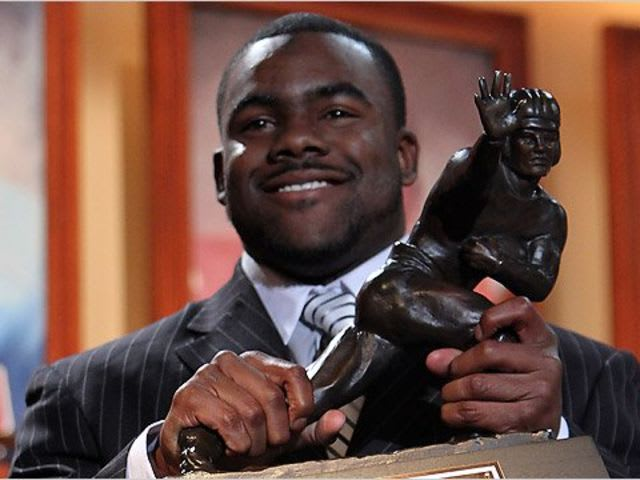 Which two schools have won the most Heisman trophies?