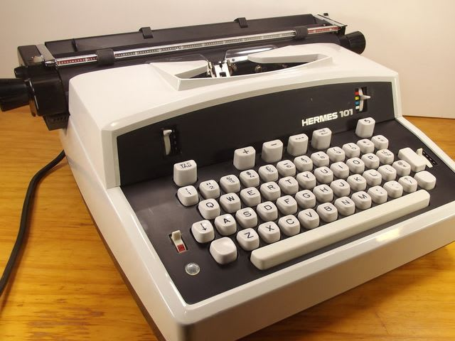 An electric typewriter had metal letters which would strike a ribbon to transfer ink or carbon impressions onto paper. They were used from the 1930s to the 1980s.