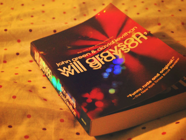 In Will Grayson, Will Grayson, what kind of shop do the Wills meet in for the first time?