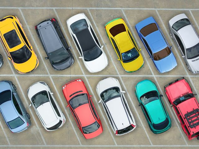 There are 136 cars in a parking lot. 25% of them are red. How many red cars are in the parking lot?