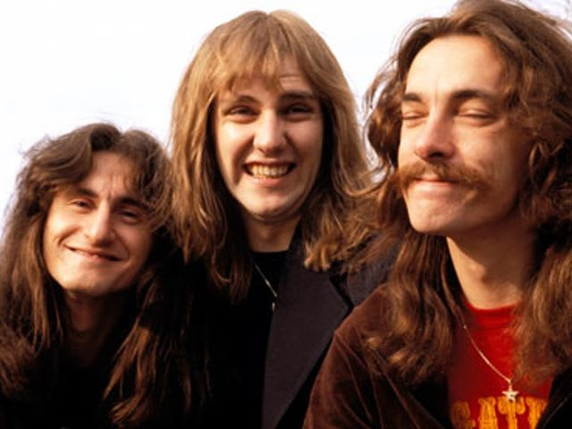 What are the names of the three members of the legendary Canadian Rock band, Rush?