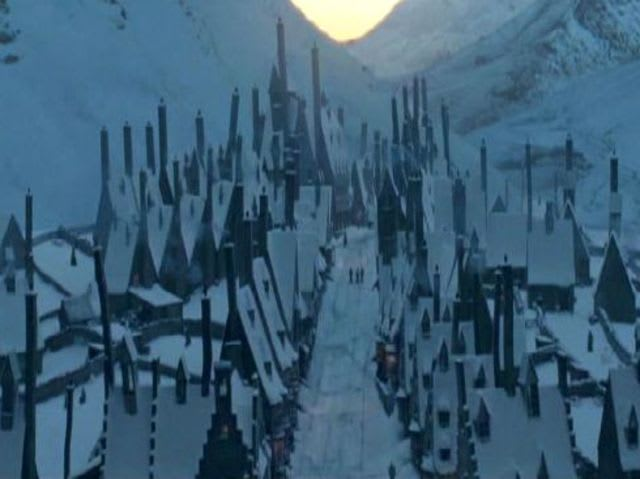 Who ended up giving Harry permission to go to Hogsmeade?