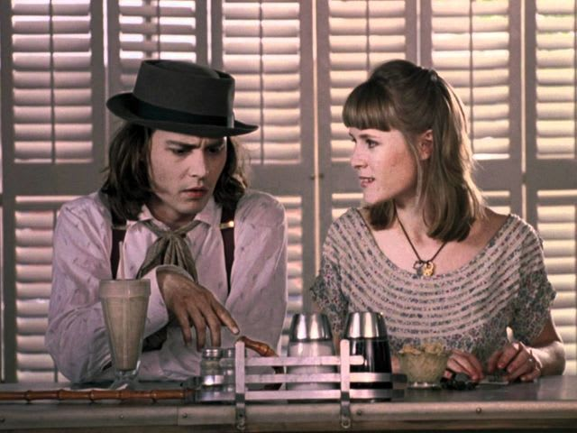 In 'Benny & Joon', what does Johnny Depp use to make grilled cheese?