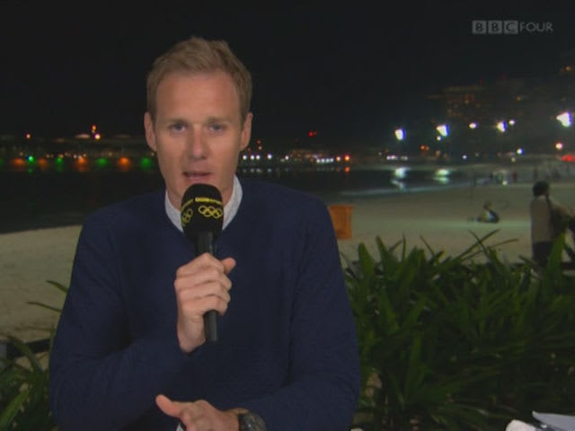 Olympics TV presenter Dan Walker's live broadcast from the Rio beach was interrupted by what?