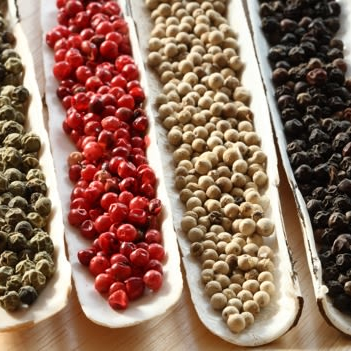Green, red, white and black pepper
