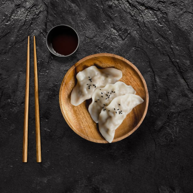 Steamed vegetarian dumplings and dipping sauce
