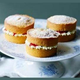 A sandwich of sponge, jam, and cream