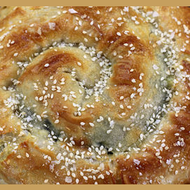 A savory, spiral pastry flavored with sesame and herbs
