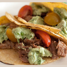 Pulled Pork Taco With Avocado Crema And Cherry Tomatoes