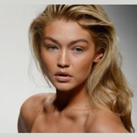 Gigi Hadid - she's a bronzed, glowing goddess