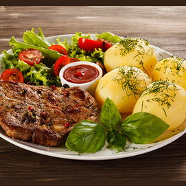 Meat, potatoes and salad
