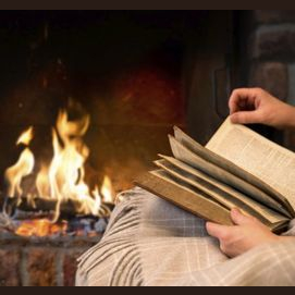 Reading a book by a warm fire