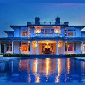 a big house with a pool