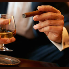 Enjoying a quality cigar at a classy lounge