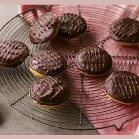 Small layered cakes of sponge, orange jelly, and chocolate
