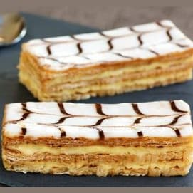 Layers of puff pastry alternating with cream or sometimes jam and usually topped with icing