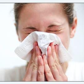 No, I try not to get it into my mouth at all by blowing my nose regularly
