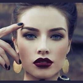 dark lipstick and light eye