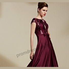 a dark colored dress with lots of bling