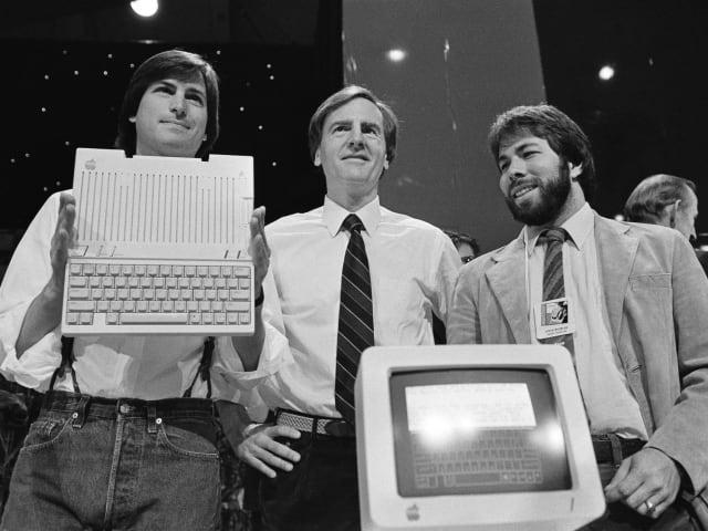 Steve Jobs, John Sculley, and Steve Wozniak, in