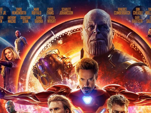 Thanos wields the Infinity Gauntlet on Marvel's enormous theatrical poster for INFINITY WAR (courtesy of Disney & Marvel Studios press materials).