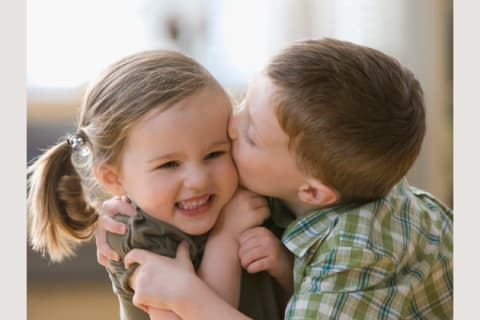 what is a good age to have your first kiss