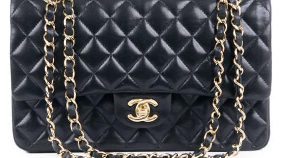 Chanel, Coach, Michael Kors, Louis Vuitton, Tory Burch, or Gucci