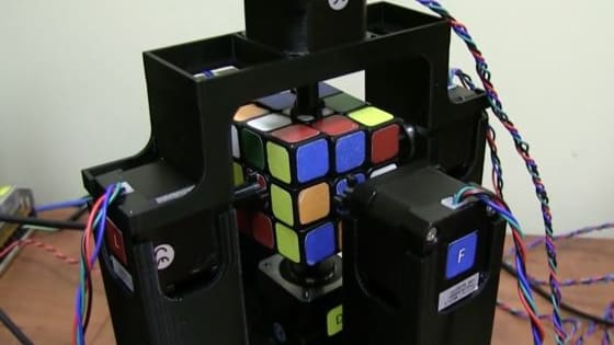 The device uses an insane algorithm to magically solve the popular toy puzzle.
