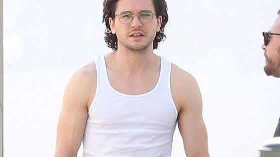 I like him as Jon Snow, but boy can rock a white tank top too!