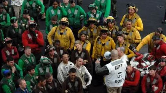 On the flight deck of a U.S. Navy aircraft carrier, different colored jerseys mean different responsibilities. Certain personality types are best suited for certain jobs. What color best matches yours? Take this quiz and find out!