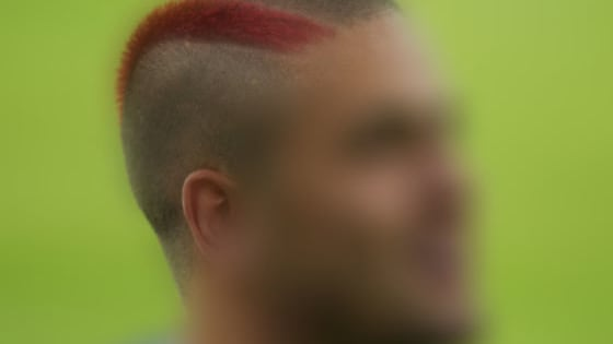 Can you tell which West Ham United player is hiding, based on the hairstyle you can see?