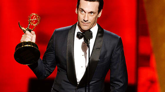Hamm's Emmy for playing the infamous Don Draper has been long anticipated... he literally climbed on stage to accept his award.