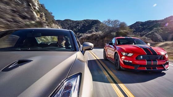 These two cars command deep followings across the world. Which one would you rather own? The JDM powerhouse or the flat plane crank american muscle car?!