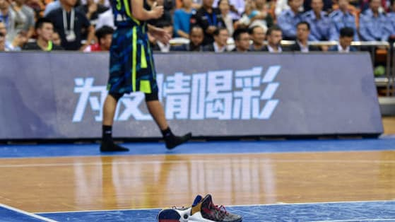 Former NBA and LA Lakers star Yi Jianlian was suspended from the CBA for removing his league-sponsored shoes in the middle of a game.