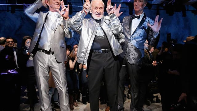Nick Graham's 2017 fall men's line is space-themed, so he needed two very special models to walk in his show with plenty of science experience. Find out more here!