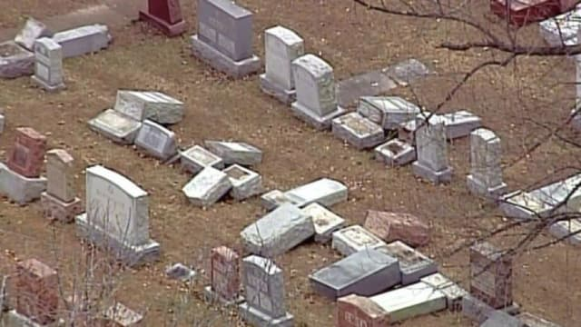The historic Jewish cemetery was the scene of what may well have been a hate crime this weekend when many of the headstones were deliberately knocked over