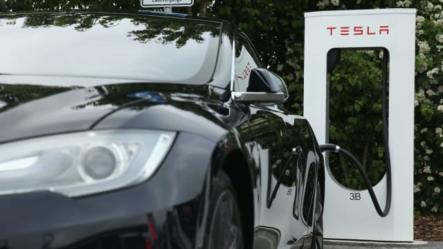 The electric car company recently surpassed Ford in market value and could soon pass GM. Find out more here!