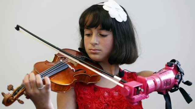10-year-old Isabella Nicola was born with a left arm that would never fully develop but always longed to play beautiful music. Now, thanks to students at George Mason University, she's well on her way with a pink prosthetic arm! Find out more here!