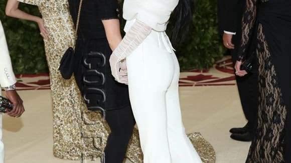 Kendall Jenner pushed a Met Gala production assistant while posing on the red carpet. Was it rude??
