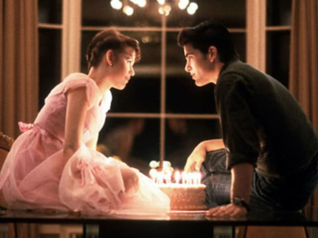 "Samantha (""Sam"") and Jake share a kiss over a birthday-cake with 16 candles."