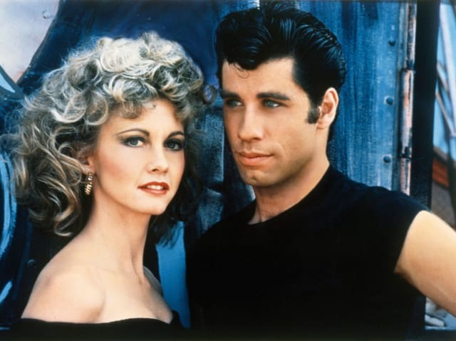 """The first time I saw Mr. Travolta was as Danny in the movie Grease. He and Olivia Newton-John had great chemistry on screen. Danny and Sandy met on the beach during summer break. Back at school the two discover that they now attend the same high school! The only problem was now Danny had to constantly try to impress his """"T-Bird"""" friends, rather than show his true feelings for Sandy."""
