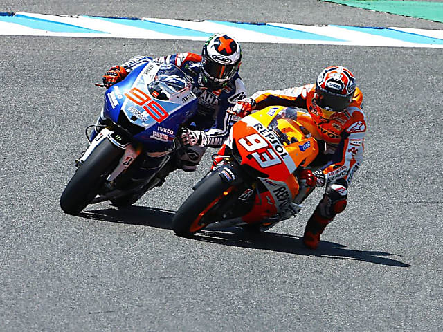 Marc Marquez perfected the leg dangle to pull over a late pass on Jorge Lorenzo during this classic fight at Jerez.