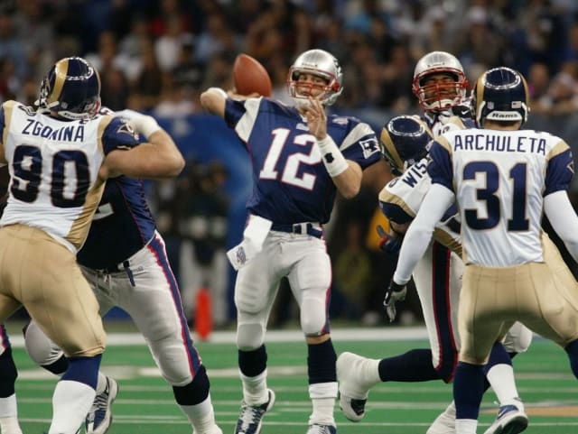 Brady only threw for 145 yards and 1 touchdown in the Patriots upset of the heavily favored 'Greatest Show on Turf' St Louis Rams in Super Bowl XXXVI. But he won Super Bowl MVP after his clutch late drive to set up Adam Vinatieri's game-winning field goal as time expired.