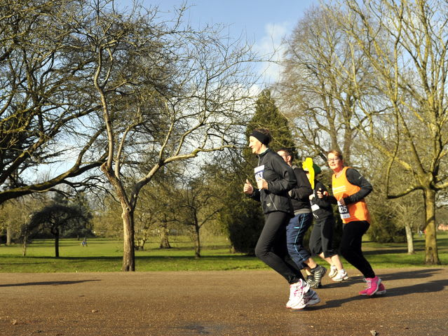 people jogging through the park