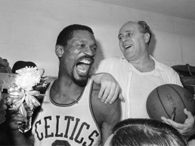 How many championships did Red Auerbach and Bill Russell win as a coach-player duo?