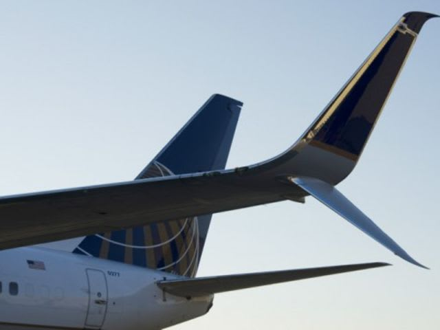 A Winglet is a short, near-vertical projection on a wing tip that reduces drag and improves fuel efficiency.