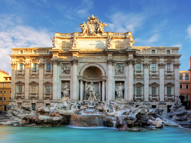 Where do you have to travel to throw a coin in the Trevi Fountain?