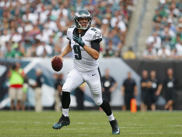 In 2013, Foles set the NFL record for TD/INT ratio whose record did he break?